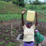 The Water Project: Emmachembe Community, Magina Spring -  Carrying Clean Water Home