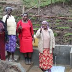 The Water Project: Emmachembe Community, Magina Spring -  Field Officer Betty In Center With Women At The Spring