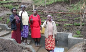 The Water Project:  Field Officer Betty In Center With Women At The Spring