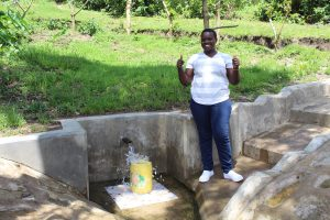 The Water Project:  Team Leader Catherine Chepkemoi Gives A Thumbs Up At Shilangu Spring