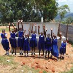 The Water Project: Goibei Primary School -  Jumping For Joy In Front Of New Latrines