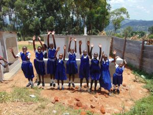 The Water Project:  Jumping For Joy In Front Of New Latrines