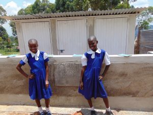 The Water Project:  Girls Pose In Front Of Latrines