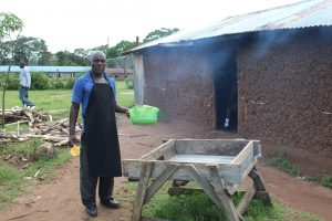 The Water Project:  School Cook At Dishrack