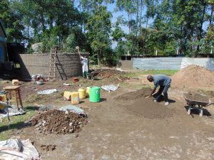 The Water Project:  Construction Materials Surrounding Rain Tank