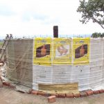 The Water Project: Mukangu Primary School -  Plastic Tarp Protecting First Cement Layer