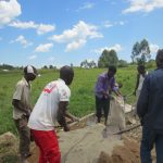 The Water Project: Chegulo Community, Sembeya Spring -  Mixing Cement