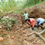 The Water Project: Hirumbi Community, Khalembi Spring -  Brickwork On Spring Foundation