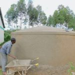 The Water Project: Elufafwa Community School -  Adding Outer Plaster To Rain Tank