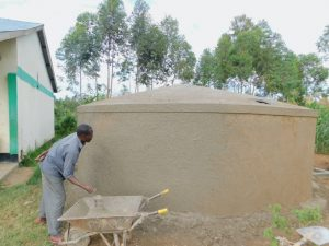 The Water Project:  Adding Outer Plaster To Rain Tank