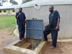 The Water Project:  School Staff Stand Proud With The Rain Tank