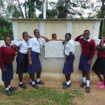 The Water Project: Ematiha Secondary School -  Girls Pose With Their Latrines