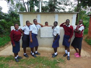 The Water Project:  Girls Pose With Their Latrines