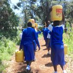 The Water Project: St. Teresa's Isanjiro Girls Secondary School -  Students Carrying Water Back To School