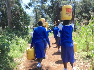 The Water Project:  Students Carrying Water Back To School