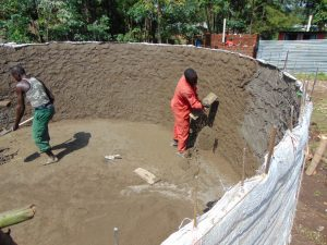 The Water Project:  Cementing Interior Of Rain Tank Walls