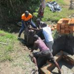 The Water Project: Chegulo Community, Sembeya Spring -  Community Members Helping Out