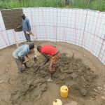 The Water Project: Shinyikha Primary School -  Cementing The Walls Inside The Tank