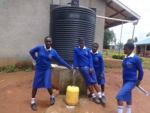 The Water Project:  Students Collecting Rainwater From A Small Tankk