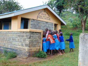 The Water Project:  Girls Squeeze In Line For The Latrines