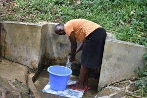 The Water Project:  Gladys Enjoying The Spring Water