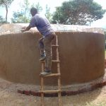 The Water Project: Womulalu Special School -  Attaching The Dome Form To The Tank