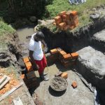 The Water Project: Chegulo Community, Sembeya Spring -  Pipe Placement Measurement