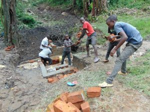 The Water Project:  Kids Help Pass Bricks