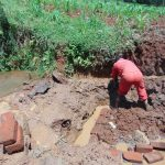 The Water Project: Shamakhokho Community, Imbai Spring -  Opening Up Drainage Channel To Divert Water
