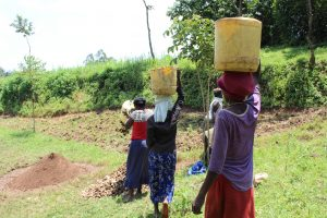 The Water Project:  Community Members Bringing Materials To Site