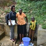 The Water Project: Mungakha Community, Asena Spring -  Field Officer Betty Mwangi Joins Gladys And Litrelius