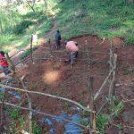 The Water Project: Mushina Community, Shikuku Spring -  Fencing And Soil Backfilling