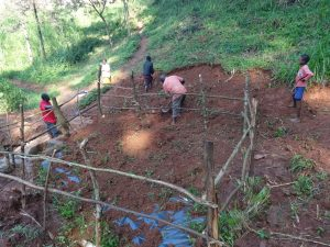 The Water Project:  Fencing And Soil Backfilling