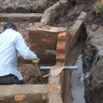The Water Project: Bungaya Community, Charles Khainga Spring -  Pipe Setting