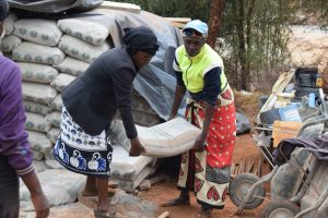 The Water Project:  Lifting Cement Bag