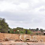 The Water Project: Mukuku Community -  Shg Members Stand On Sand Dam