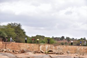 The Water Project:  Shg Members Stand On Sand Dam