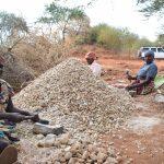The Water Project: Mukuku Community -  Women Break Down Rocks For Dam Construction