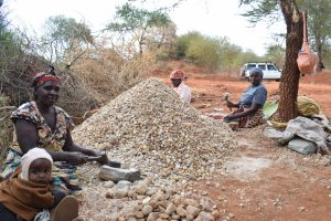 The Water Project:  Women Break Down Rocks For Dam Construction