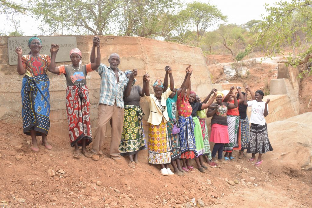 The Water Project : kenya19197-shg-members-at-their-new-dam