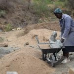The Water Project: Mbiuni Community -  Mixing Cement