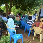 The Water Project: Mbiuni Community A -  People Listen During The Training