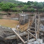 The Water Project: Mbiuni Community A -  View Of Well And Dam During Construction