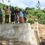 The Water Project: Mbiuni Community -  Shg Members Celebrate On Top Of The Sand Dam