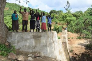The Water Project:  Shg Members Celebrate On Top Of The Sand Dam