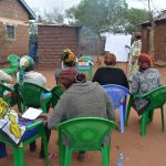 The Water Project: Kathuli Community -  Attendees Listen During The Training
