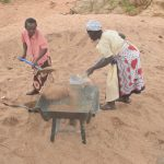 The Water Project: Kathuli Community -  Filling Wheelbarrow With Sand