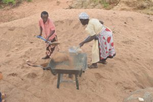 The Water Project:  Filling Wheelbarrow With Sand