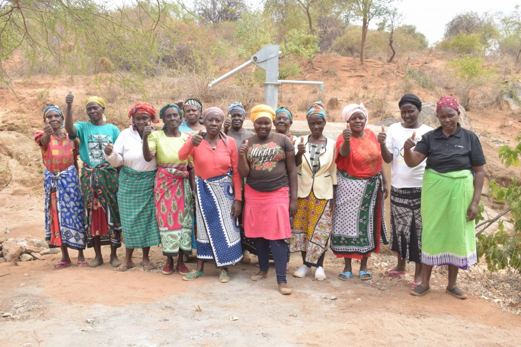 The Water Project : kenya19222-shg-members-celebrate-their-new-well