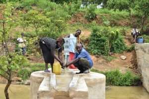 The Water Project:  Collecting Water At The New Well